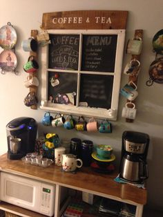Coffee bar made from repurposed dresser. Chalk board made from repurposed old wooden window. Coffee mug holder and wooden sign made from old barrel staves.