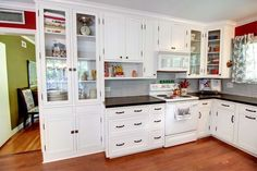 Traditional Kitchen with Crown molding, Hardwood floors, Inset cabinets, Penny Tile, European Cabinets, Glass panel, L-shaped
