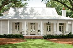 Creole-French-style cottage beckons visitors in with an easygoing porch and a simple, modern design - Breezy River House Exterior - Southern Living Future House, My House, House Porch, House Front, Boat House, Exterior Paint Colors, Southern Homes, Southern Charm, Southern House Plans