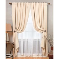 Design your window with this elegant and functional sheer curtain. This blackout curtain set provides protection from heat and cold through insulation and extra lining. The set includes two blackout curtain panels and two long crushed sheer panels.