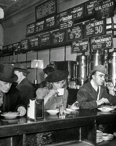 In a quick-eats joint on Sixth Avenue, NYC 1940. Try a knockwurst for only twenty cents!