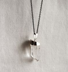 I have a necklace like this that my dad made for me out of some quartz we found in Colorado when I was 9 :)