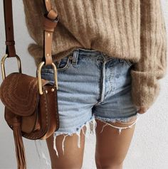 A ribbed camel sweater with vintage shorts and a suede saddle bag.
