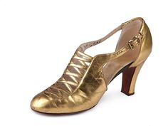 Gold leather Spanish heels shoes, decorated with criss-cross straps sewn into a cut-out in the centre of high vamp, France, 1933-36