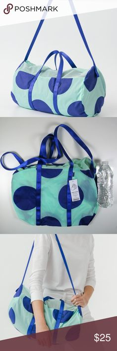 """Baggu Nylon Sport Duffel Bag Brand new with tags  Great for daily trips to the gym or a small overnight bag Top mesh panels allow breathability Duffel compacts into its own circular pocket 2 handles with strap for over the shoulder or cross body Inner zip pocket 16"""" Width x 10"""" Height Folds into a 10"""" circular pouch 35"""" shoulder strap 100% Polyester mesh & 100% ripstop nylon Machine washable (cold water only) Line dry only. Color: Mint Big Dot Baggu Bags Travel Bags"""