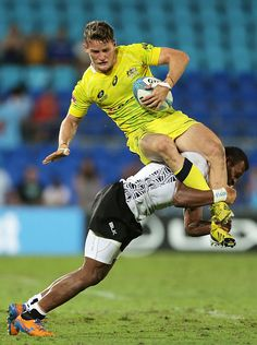 Con Foley of Australia is tackled by Sainivalati Ramuwai of Fiji during the 2014 Gold Coast Sevens Pool C match between Australia and Fiji at Cbus Super Stadium on October 11, 2014 in Gold Coast, Australia. (Photo by Mark Metcalfe/Getty Images)