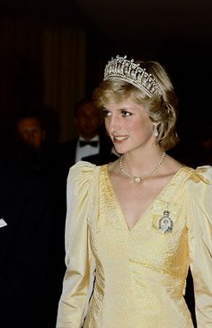 DOUBLE STRAND PEARL AND GOLD BEAD NECKLACE WITH CENTRAL GOLD HEART  Princess Diana also wearing Tiara  Princess Diana wears Queen Mary's tiara and family order of Queen Elizabeth pin.   June 23, 1983 in Canada