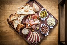 Toms Kitchen charcuterie board, chicken liver parfait, smoked duck breast, pork rilette, parma ham, toasted sour dough, pickles and chutneys.