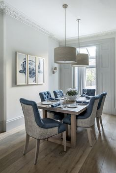 Modern London Town House in Primrose Hill | Dining room idea with blue upholstered chairs and pendant lghts over the dining table |  Sims Hilditch Interior Design The City Townhouse London