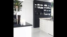 Black countertop White floors Kitchen