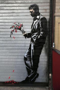 """Street art on the side of a """"hustlers"""" club, located in New York by Banksy (October 2014) This graffiti only last a few hours before the owners took it away to put it on sale for several bucks."""