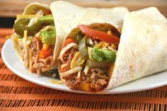 Slow Cooker Pulled Chicken Tacos are so easy to make and totally delicious. Only a few ingredients and only a few minutes of preparation time. A great weekday meal served in a soft tortilla or on top of rice. Both ways taste so yummy! You have to give this recipe a try!    …