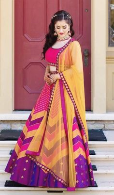 Looking for Multi Colour Lehengas to wear to your mehendi and sangeet? Check out these amazing designers and know their lehenga prices in this post. Half Saree Lehenga, Lehnga Dress, Pink Lehenga, Lehenga Blouse, Indian Lehenga, Bridal Lehenga Choli, Indian Designer Outfits, Designer Dresses, Designer Clothing