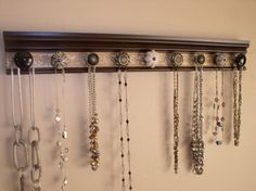 """jewelryorganizer. This necklace holder has 9 decorative cabinet knobs. Brown with bronze  embossed background 26"""" jewelry storage"""