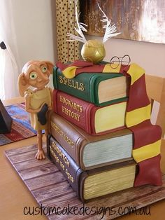Dobby Harry Potter Cake Dobby is free! This 4 tier Harry Potter book cake featuring a hand sculpted Dobby (holding his sock of. Dobby Harry Potter, Harry Potter Book Cake, Harry Potter Wedding Cakes, Gateau Harry Potter, Harry Potter Bday, Harry Potter Birthday Cake, Harry Birthday, Harry Potter Food, 8th Birthday