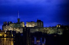 Edinburgh Castle perches on a rock overlooking the city giving it a forbidding silhouette. Edinburgh Castle, About Uk, Castles, New York Skyline, Hunting, Tours, Silhouette, Good Things, Spaces