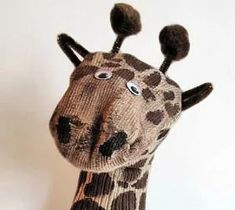 40 Simply Adorable Old Sock Craft Ideas - HubPages Sock Crafts, Horse Crafts, Sock Snake, Diy Doll Pattern, Monkey Doll, Monkey Puppet, Giraffe Socks, How To Make Socks, Sock Cupcakes