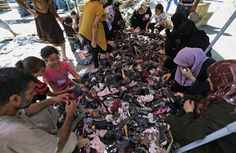This photo shows Palestinian women looking for new shoes for their kids. This photo was taken inside Jebaliya refugee camp in the North part of the Gaza strip.