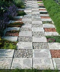 The checkerboard path features alternating squares of concrete, crushed brick and gravel.