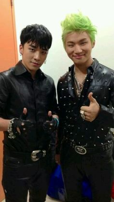 Daesung is stylin with that green hair and studded shirt