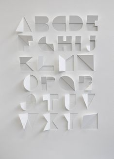 Found on the internet:Alphabet made out of a sheet of paper by cuts and folds by Gina Hollingsworth , a summer school student at Centr...