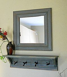 furniture extraordinary entry mirror with hooks for distressed wood coat rack including floating shelving units and framed square mirror mounted on sand textured wall paint