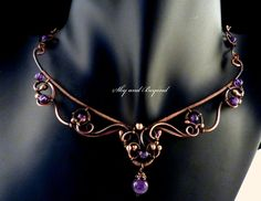Stunning amethyst and copper wrapped necklace