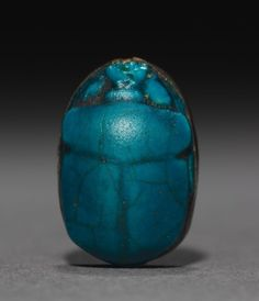 Scarab, 1980-1648 BC, Middle Kingdom, late Dynasty 12 to Dynasty 13 - blue-green glazed steatite, gold mount