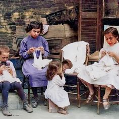 Children doing piece work outside their tenement home in Somerville, Massachusetts. Colorized by Steve Smith.