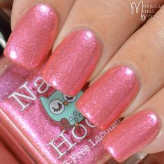 Hanging Fuschia is a lovely pink polish has heavy shimmer and is inspired by a pot of hanging fuchsia. It is opaque in two coats. This polish is part of the Fancy Floral collection.