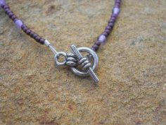 Japanese glass beads and amethyst bracelet. Silver-plated brass fob clasp. $15 (BR53). www.feeko.co.za