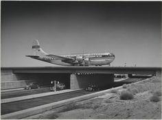 Pan American World Airways' plane on runway bridge over the automobile road at Idlewild, the New York International Airport