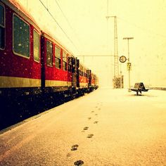love the red train in an all white picture