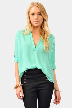 Again with the cute mint. But I live how the mint blouse is tucked in , in the front to accent the Hugh waisted pants.