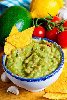 Stock Photo - Fresh guacamole dip with avocado, ingredients and nacho chips Guacamole Dip, Fresh Guacamole, The Kitchen Food Network, Nacho Chips, Party Finger Foods, Nachos, Food Network Recipes, Dips, Avocado