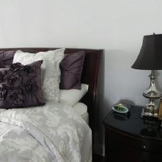 Purple and Grey Bedroom; those purple flower pillows are what I'm looking for!!