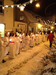 The festival of Santa Lucia in Mariefred, Sweden,  celebrated before dawn, December 13th early