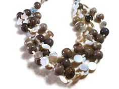 $48.00 Beautiful neutral and mauve banded sea urchin #shell, twisted with natural brown lip shell. This necklace is sold, but I can make a similar one upon request. Just ask!