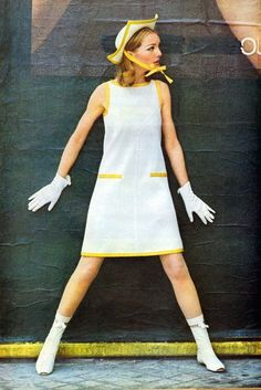 Andre Courreges fashions brought in the hot trend of wearing short white plastic go go boots in 1965