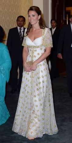 Pin for Later: The Top 13 Times Kate Middleton Played Fashion Diplomat A Nod to Malaysia's National Flower In September 2012, Kate wore a white and gold Alexander McQueen dress that was stitched with gold hibiscus, Malaysia's national flower.