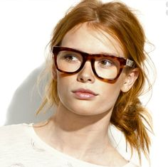 Barely-there makeup and messy hair balance the bold specs.