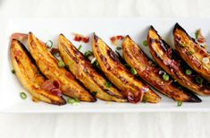 Sweet Potato Wedges with Bacon VinaigretteCrispy potato wedges tossed with a vinaigrette of bacon, maple, and scallions.