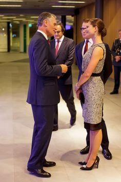 Crown Princess Victoria of Sweden talks with the President Aníbal Cavaco Silva at a cocktail party 10/2/2013