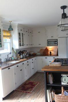 Custom kitchen on a budget - subway tile, IKEA butcher block countertops, undermount sink, bridge faucet, thrifted light fixtures