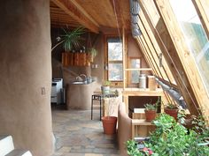 Earthship Corridor/Greenhouse: Sunroom Kitchen