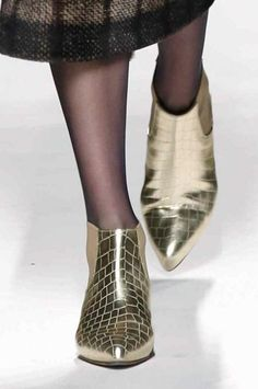 These golden crocodile boots stole the show for #AW14 at maxmara...