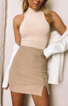 Beige Skirt  Perfect winter basic  Small front slit    Mini Length  Ribbed, knit fabric  Invisible zip at middle back  Light-weight, stretchy fabric  May appear slightly sheer when stretched