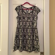 Tribal print dress Tribal print dress with small keyhole in back. Worn, but in very good condition. Although it's labeled a 2X, it fits more like a L/XL. Delirious Dresses Midi