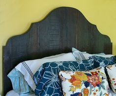 Inexpensive DIY Wood Headboard Made Out Of Cedar Fence Boards cut into a formal shape - could use reclaimed wood.