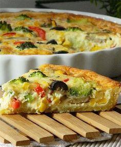 Вегетарианский овощной киш Рецепт:Вегетарианский овощной кишТесто (форма = 26 см):250 г муки1 яйцощепотка соли125 г холодного масла, нарезанного кубиками2 столовых ложки холо...